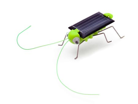 Grasshopper - solar powered toy isolated on white photo