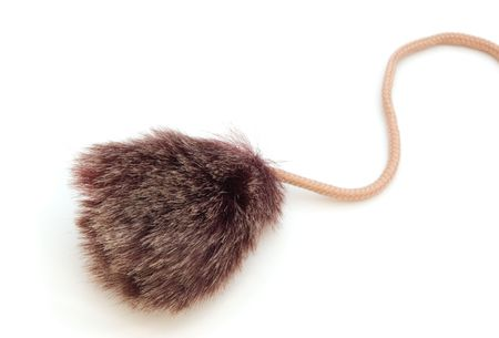 pompon: Fur pompon on lace isolated on white