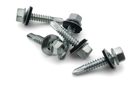 Group of roofing screws isolated on white photo