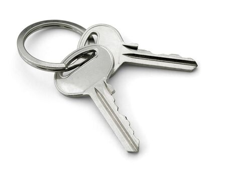 Two keys on a keyring isolated on white photo