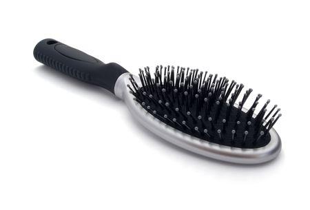 Spazzola per capelli d'argento isolato su bianco