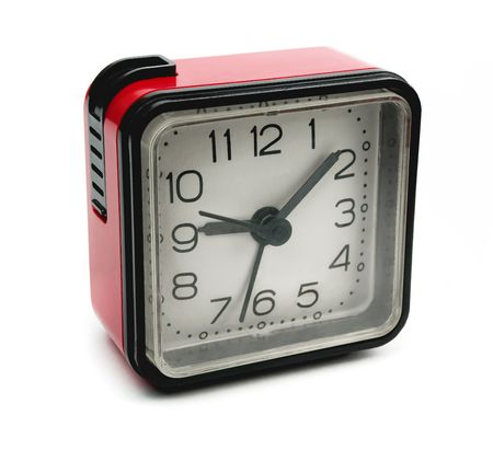 Old square red alarm clock isolated on white photo