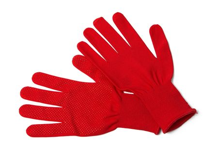 Pair of red textile working gloves isolated on white photo