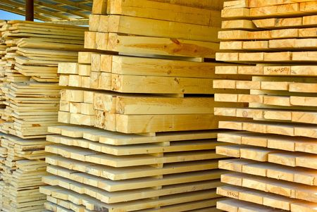 lumber mill: Assorted stacked lumber on stock of commercial timber Stock Photo