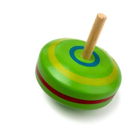 Vecchio giocattolo superiore di filatura in legno isolata on white