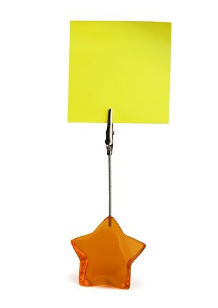Yellow sticky note in paper holder isolated on white photo