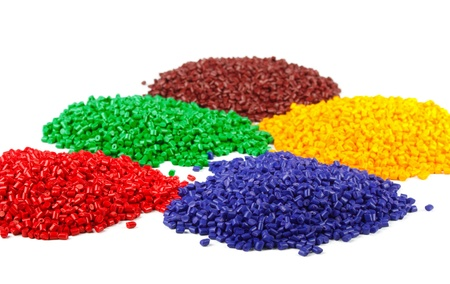 plastic: Colourful plastic polymer granules isolated on white
