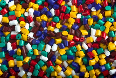Colorful industrial plastic granules background photo