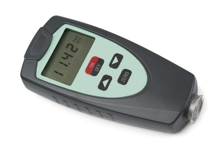 thickness: Electronic coating thickness gauge isolated on white