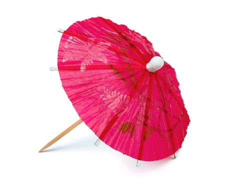 paper umbrella: Pink paper cocktail umbrella isolated on white Stock Photo