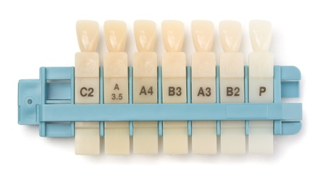 dental image: Dental teeth shades samples isolated on white