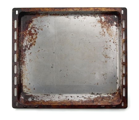 Old oven baking tray isolated on white photo