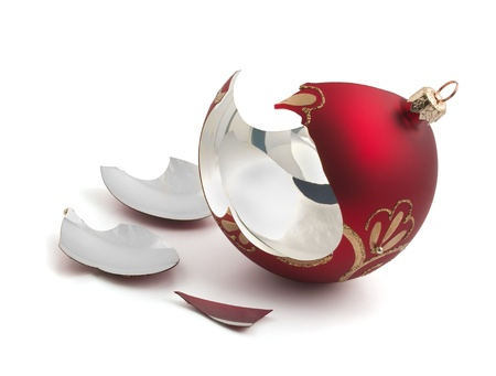 Broken red glass Christmas ball isolated on white