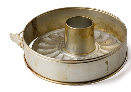 dirty dishes: Old fluted tube baking pan isolated on white Stock Photo