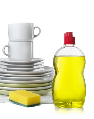 detergents: Bottle of dishwashing liquid and stack of utensils isolated on white