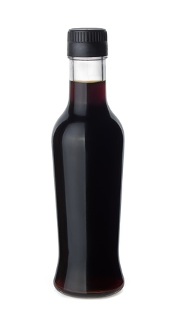 Bottle of soy sauce isolated on white photo