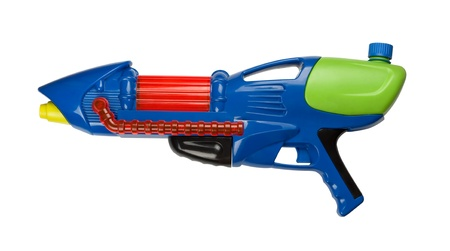Blue plastic water squirt gun isolated on white photo