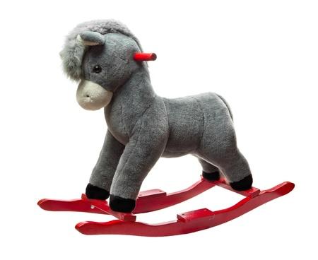 pony tail: Plush rocking toy donkey isolated on white