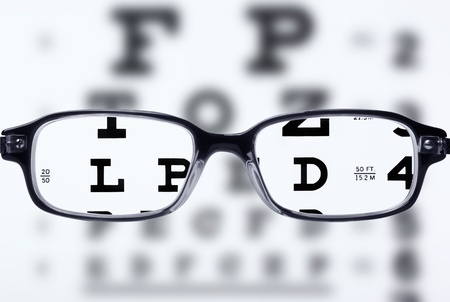 Reading eyeglasses and eye chart Stock Photo - 9384065