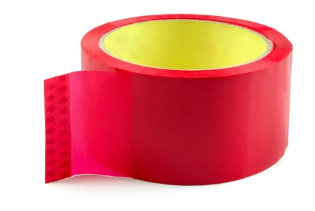 Roll of red adhesive plastic tape isolated on white photo