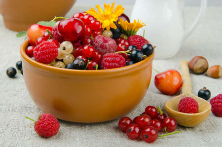 Still life of summer berries - cherries, strawberries, currants and etc photo