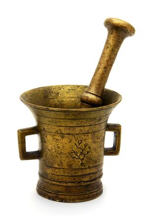 Antique bronze mortar and pestle isolated on white photo
