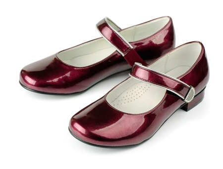 Red girls patent leather shoes isoalted on white Stock Photo - 10364782