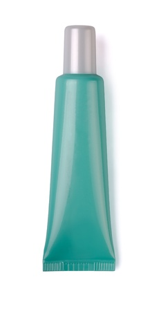 Green plastic cosmetic tube isolated on white photo