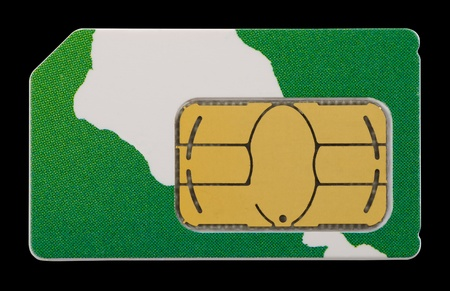 Green SIM card isolated on black background photo