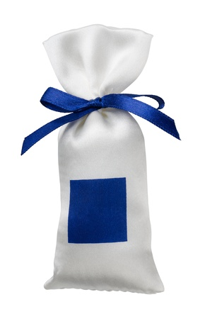 White silk gift bag with empty blue label isolated on white photo