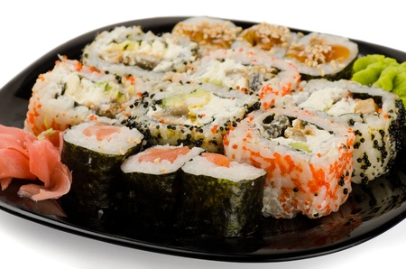 person appetizer: Set of japanese sushi rolls on black plate