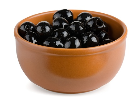 pitted: Terracotta bowl of black pitted olives isolated on white Stock Photo