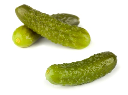 Three pickled gherkins isolated on white background Stock Photo