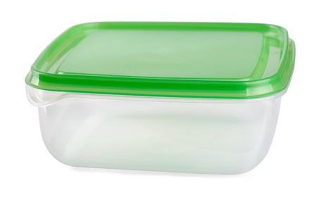 Empty food plastic container with green lid isolated on white photo