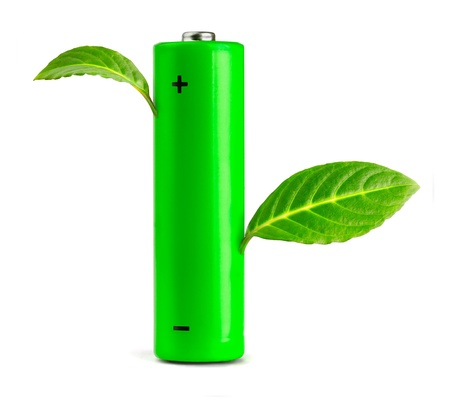 Green leaves growing from the battery.  Eco concept  photo