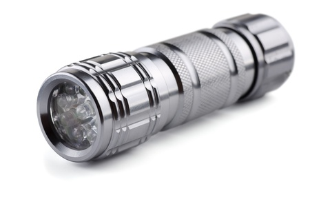 Pocket metal led flashlight isolated on white photo