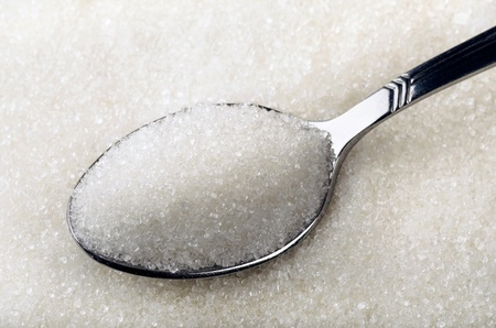 Tea spoon of white granulated sugar  photo