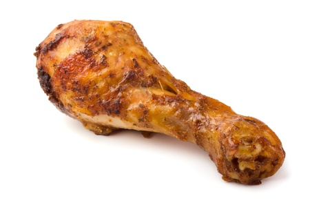 Fried chicken drumstick isolated on white photo