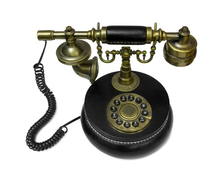 antique phone: Old style telephone made of brass and leather isolated on white