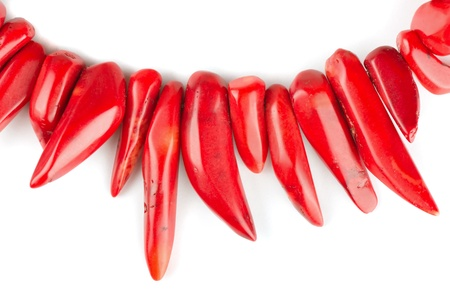 gewgaw: Red natural coral necklace on white background Stock Photo