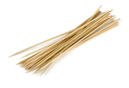 Bamboo wooden skewers isolatred on white