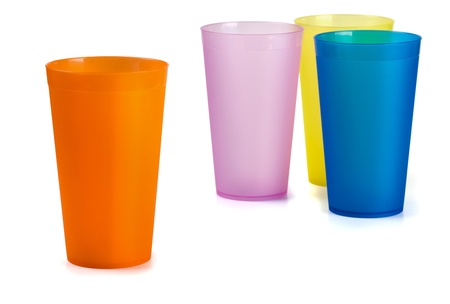disposable: Four colorful plastic cups isolated on  white