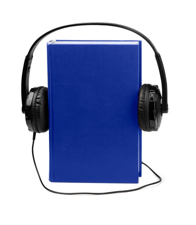 Audiobooks concept - blue book and headphones isolated on white photo