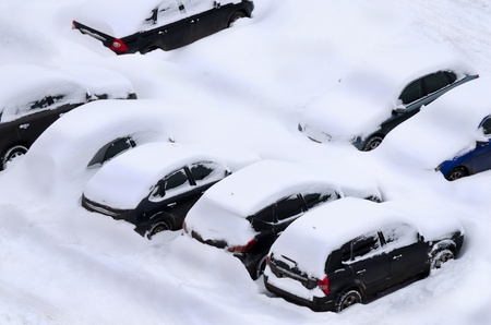 Snow covered car parking lot photo