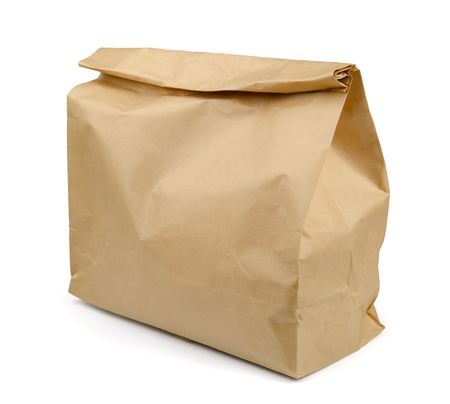 Brown paper lunch bag isolated on white photo