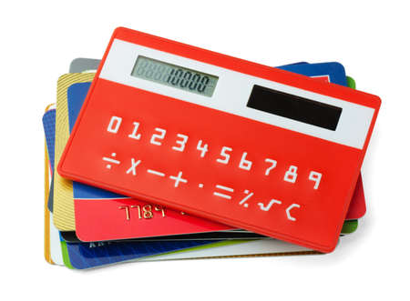 Red calculator and plastic credit cards isolated on white Stock Photo - 12811024
