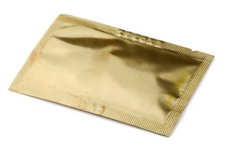 sachet: Golden small cosmetics  sachet   isolated on white