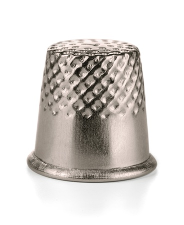 thimble: Metal sewing thimble isolated on white