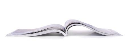 Panoramic shot of open magazine isolated on white