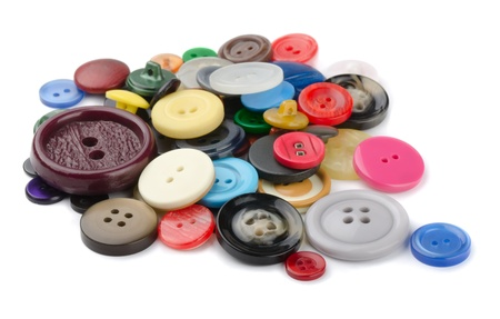 sewing item: Pile of  sewing  buttons isolated on white